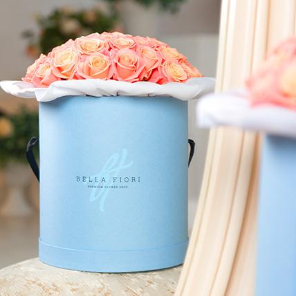 Персиковые розы в коробке