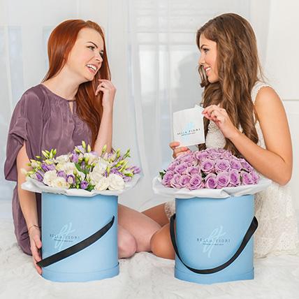 Сиреневые розы в коробке